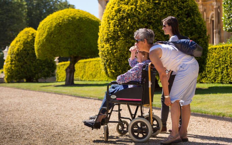 Visitors and wheelchair enjoying the grounds