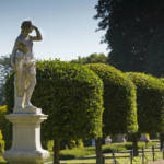 Statue and clipped hedging on the parterre