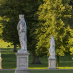 4 continents statues, located by the entrance drive to Waddesdon manor