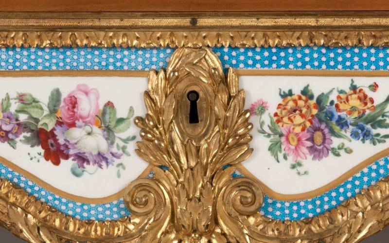 Rectangular fall-front desk with gilt-bronze mounts and ten Sèvres plaques with turquoise borders and baskets of flowers.