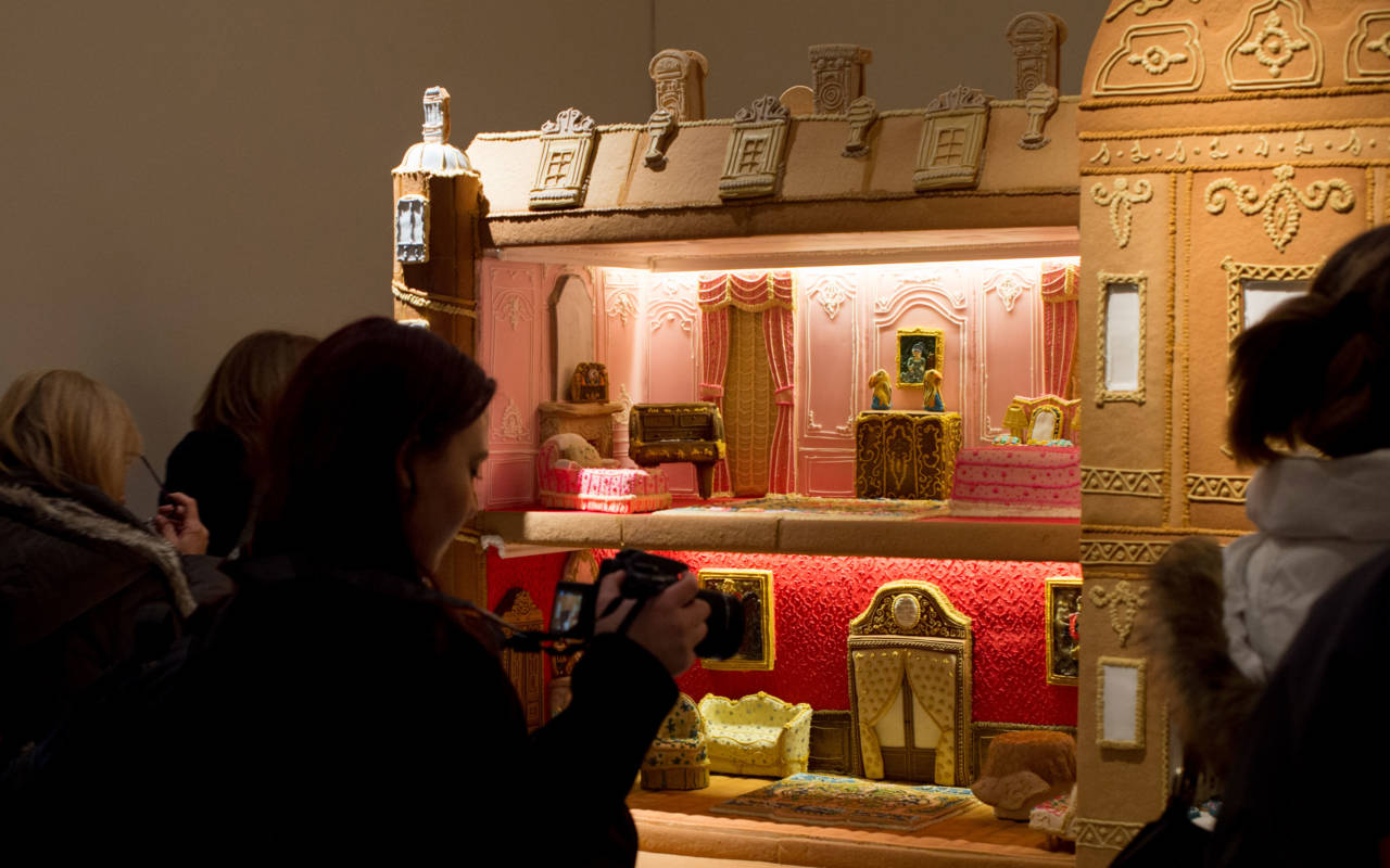 Guests taking photos of Waddesdon gingerbread house
