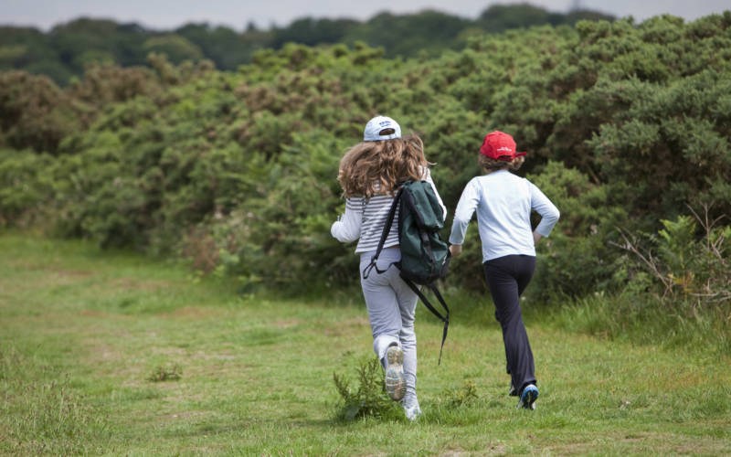 Children enjoying orienteering in a National Trust property