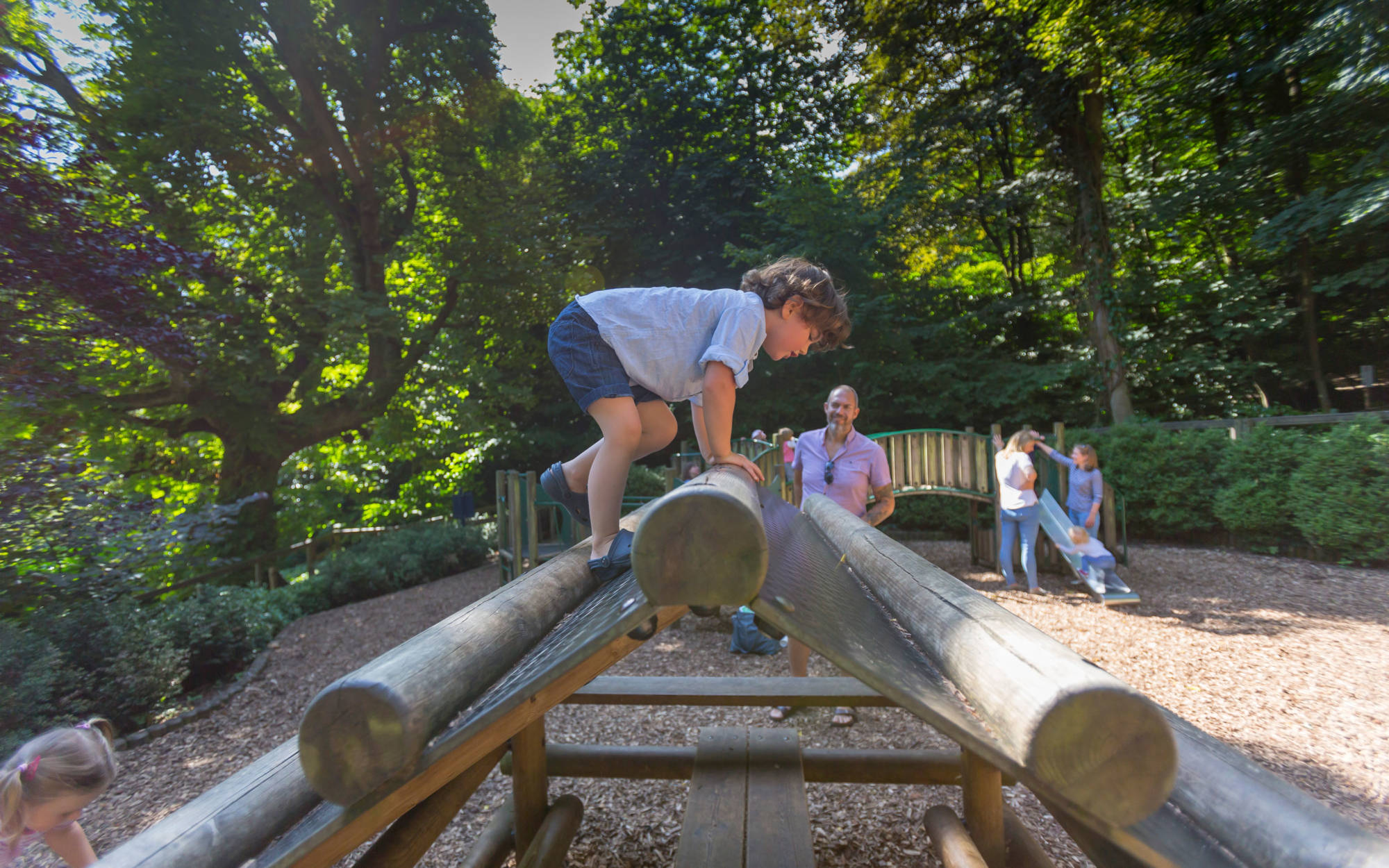 A young visitor using the climbing frame