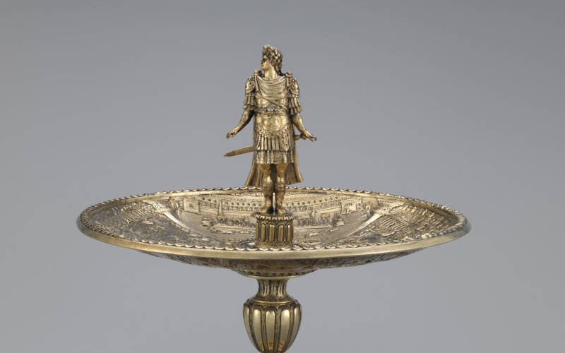 close up of the Renaissance silver gilt Augustus figure and Domitian dish, part of the Silver Caesars exhibition