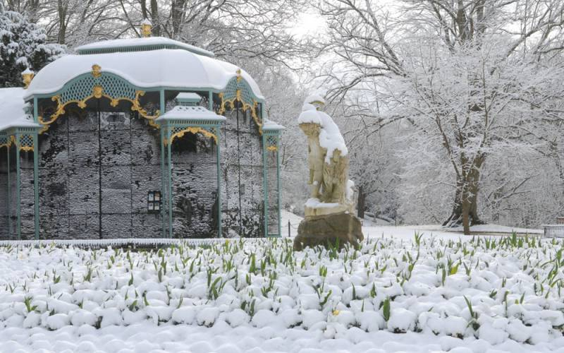 Snow covered aviary garden