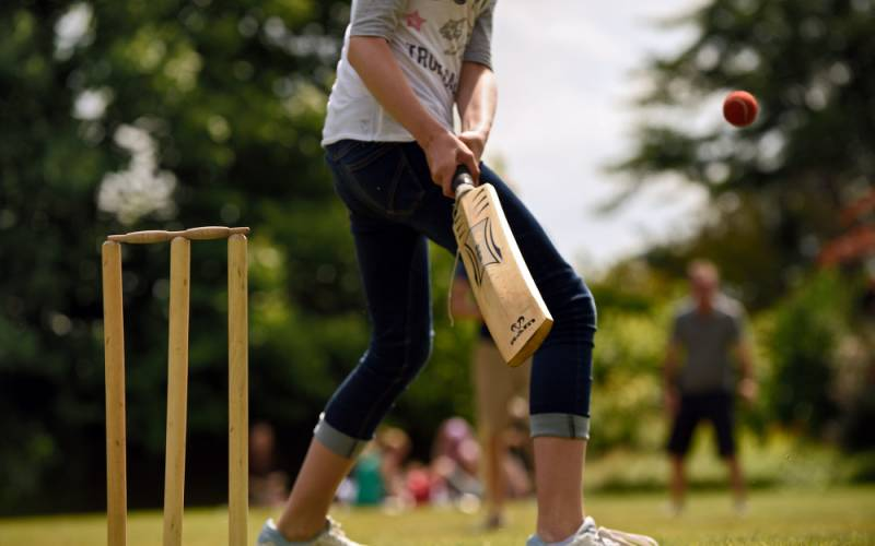 Young child playing cricket