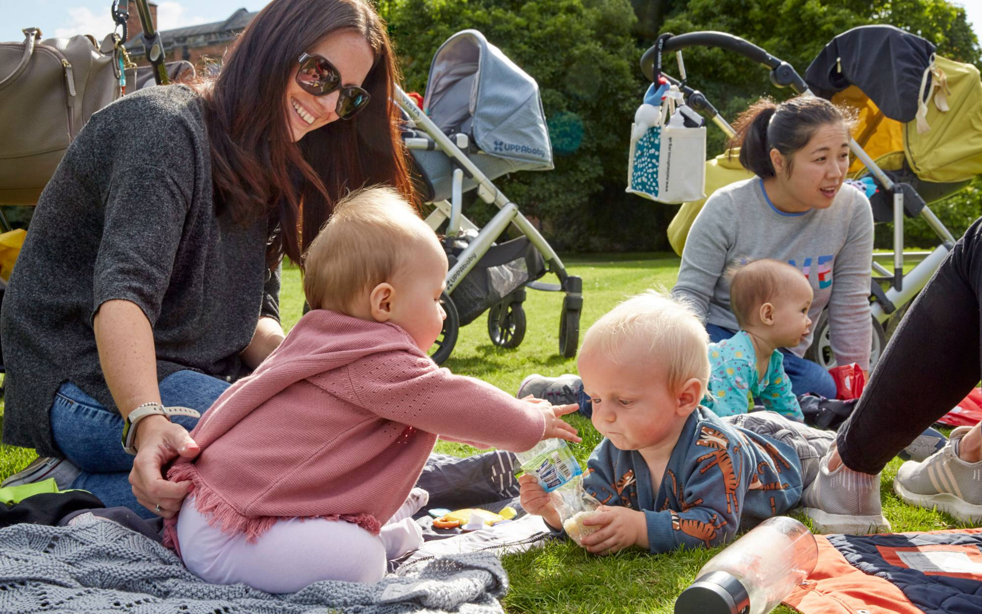 A family with young children enjoying a picnic