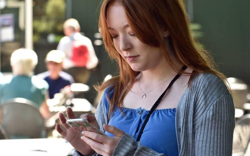 Visitor-on-her-phone-National-Trust-John-Millar