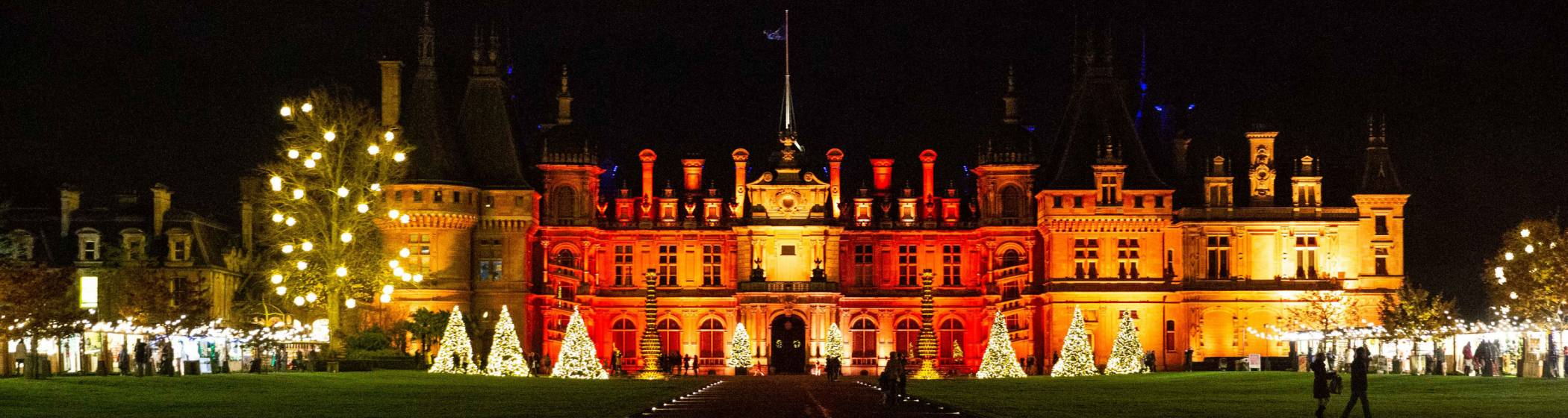 House illuminated in colour at Christmas
