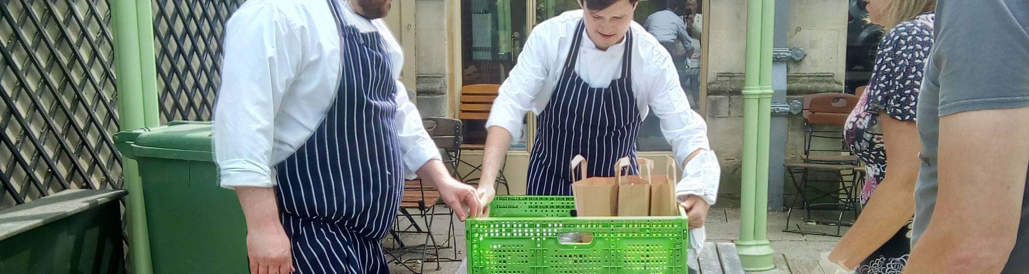 Waddesdon chefs packing up food ready for delivery
