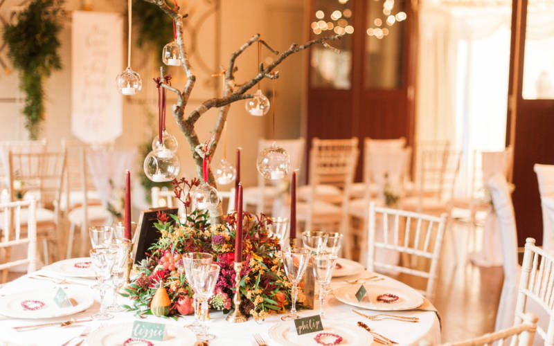 Weddings-Five-Arrows-Christmas-OCH-reception-table-empty-kate-nielen