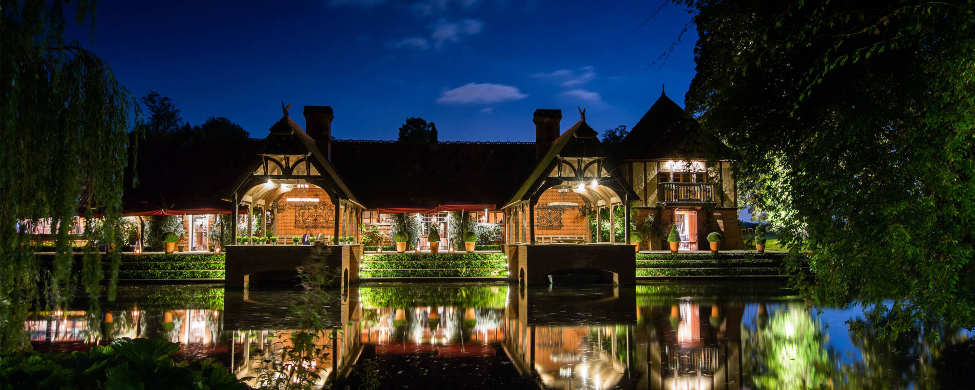 the Lakeside Terrace at the Dairy lit up at night
